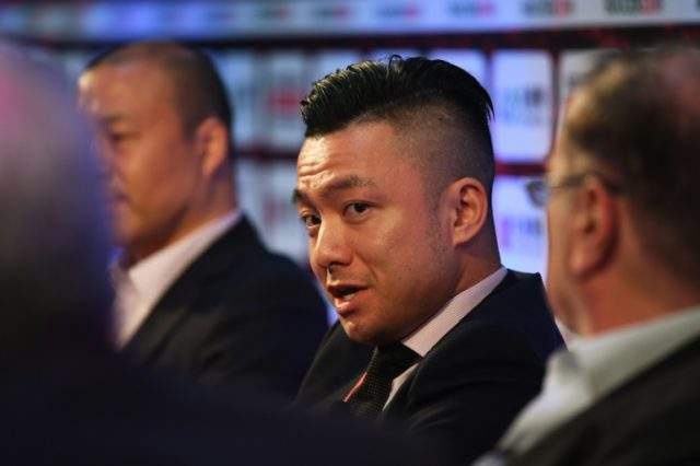 Lander Sports executive vice president Neil Chen speaks at the Soccerex China convention