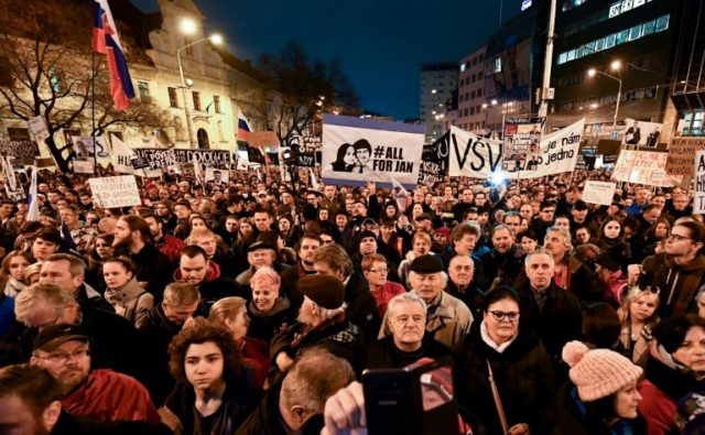 People take part in a rally against corruption and to pay tribute to murdered Slovak journalist Jan Kuciak and his fiancee Martina Kusnirova in March 2018 in Bratislava, Slovakia