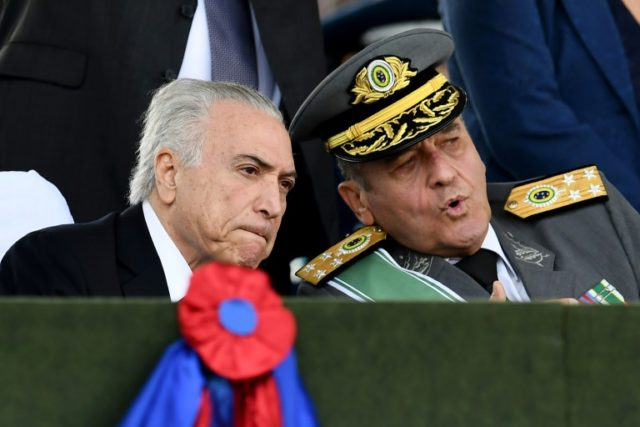 Brazilian President Michel Temer (L) with army commander General Eduardo Villas Boas during the Army Commemorative Day parade in Brasilia on April 19, 2018
