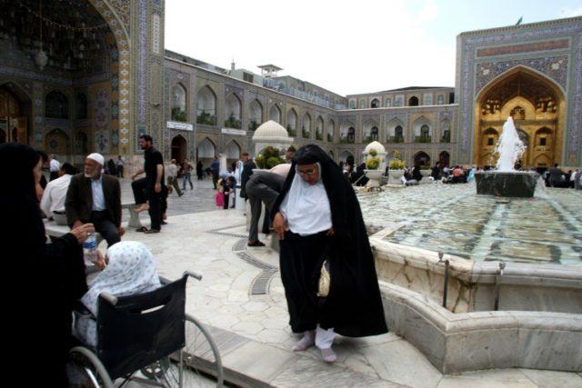 Iranian pilgrims visit the Shiite Muslim shrine of Imam Reza in the holy city of Mashhad on May 31, 2009