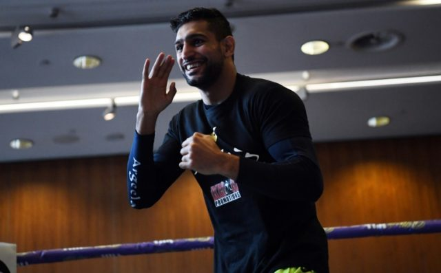 Britain's Amir Khan attends a pre-fight public work out at Paradise Place in Liverpool on April 17, 2018, ahead of his welterweight boxing bout against Canada's Phil Lo Greco set for April 21