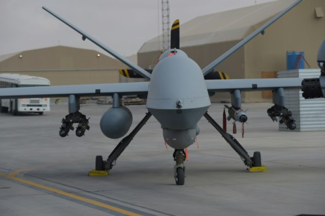"US officials say American firms are losing sales of armed drones like the MQ-9 Reaper -- seen here on an air base in Afghanistan -- to Chinese ""knock-offs"" because of the policy of the previous US administration to limit access to the weapons systems"