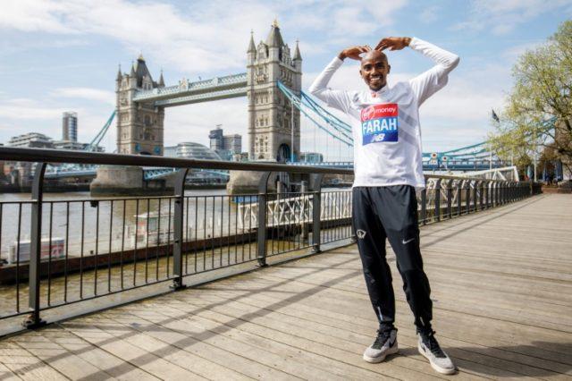 Britain's Mo Farah poses for the media during a photo call for the London marathon near Tower Bridge
