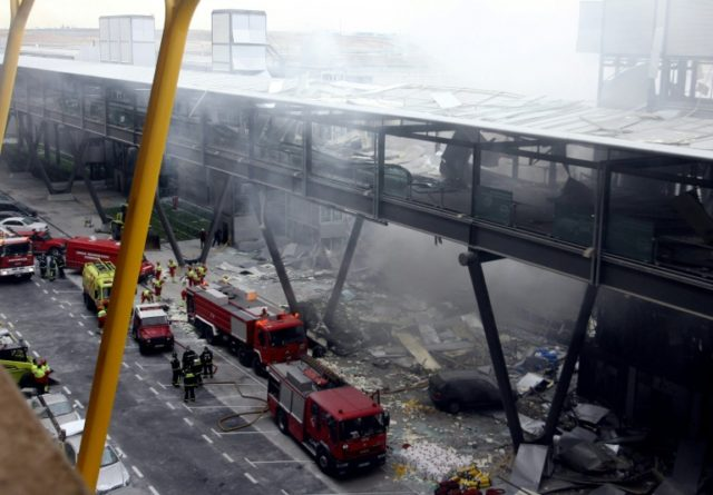 On December 30, 2006 firefighters work inside the car park of Terminal 4 of Barajas Airport in Madrid after a bomb by armed Basque separatist group ETA exploded, killing two people.