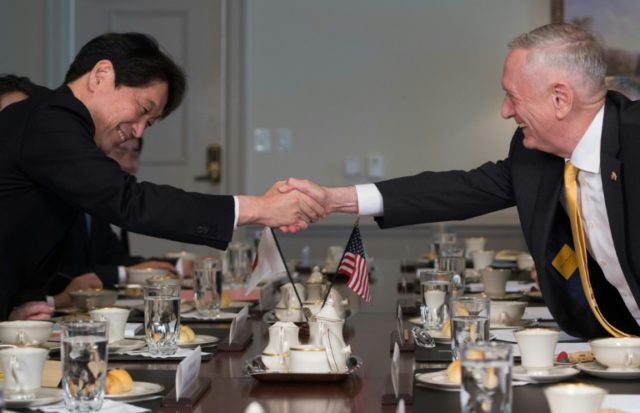 US Secretary of Defense Jim Mattis shakes hands with Japanese Defense Minister Itsunori Onodera during a meeting at the Pentagon