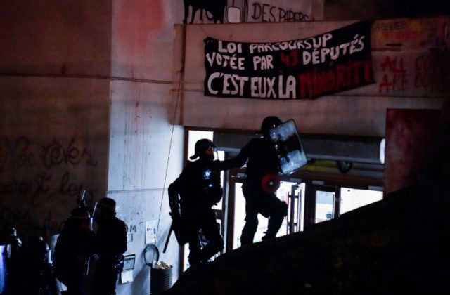 Around 100 French police stormed a campus building in Paris on Friday, ending a weeks-long sit in by students there