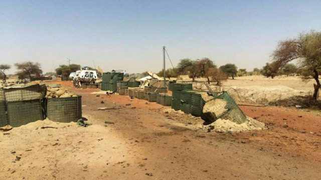 """A picture taken on April 16 shows damage at the entrance of the UN international troops' """"Super Camp"""" neighbouring Timbuktu's airport following an attack claimed by the Sahel's main jihadist alliance"""