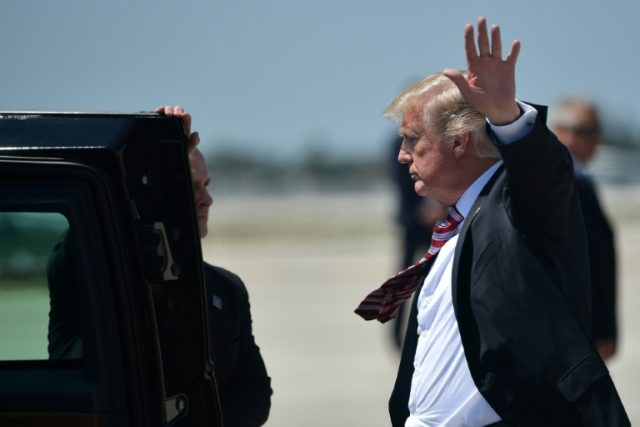 Unable to shake legal problems: President Donald Trump stepping off Air Force One in West Palm Beach, Florida on April 18, 2018