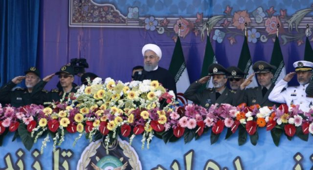 Iranian President Hassan Rouhani attends a parade on the occasion of the country's annual army day on April 18, 2018 in Tehran