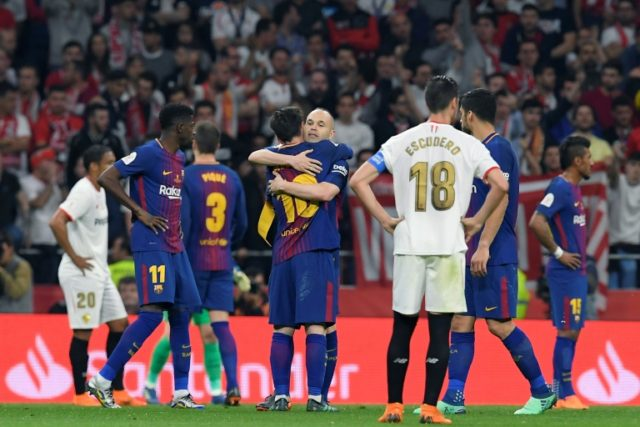 Fond farewell: Andres Iniesta hugs Lionel Messi before leaving the field