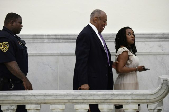 Bill Cosby walks with publicist Ebonee Benson during a break in his sexual assault trial at the Montgomery County Courthouse on April 18, 2018 in Norristown, Pennsylvania
