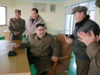 This undated picture shows North Korean leader Kim Jong Un at a test of a newly developed high-thrust engine at the Sohae Satellite Launching Ground in North Korea