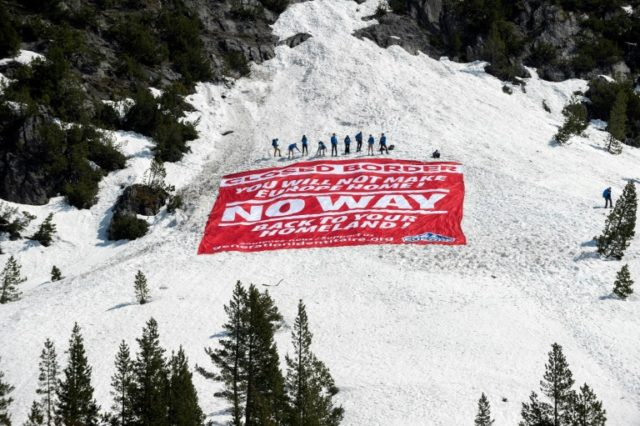 "Members of the right-wing Generation Identity (GI) movement trudged through the snow up to Col de l'Echelle near the border with Italy where they erected a ""symbolic border"" and unfurled a huge banner telling migrants to go ""back to your homeland"""