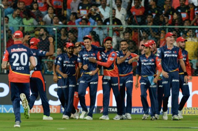 Trent Boult (fourth from left) is mobbed by his Delhi Daredevils teammates after his stunning catch
