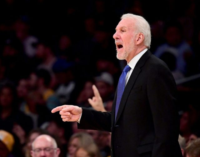 Gregg Popovich of the San Antonio Spurs talks to his players from the sidelines during the first half against the Los Angeles Lakers at Staples Center on January 11, 2018 in Los Angeles, California