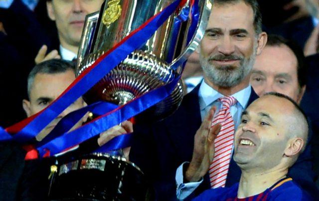 Andres Iniesta lifts the Copa del Rey