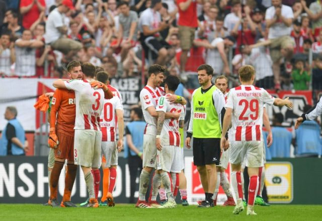 Down and almost out: Cologne's players react after their 2-2 draw with Schalke