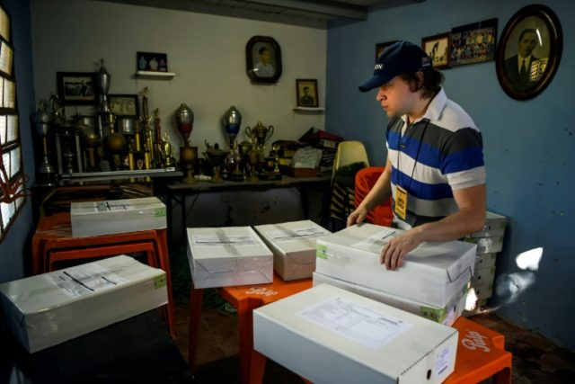 A worker arranges voting material at a polling station ahead of Paraguay's upcoming presidential elections in Asuncion on April 21, 2018