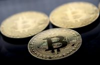 Gold plated souvenir Bitcoin tokens are displayed in London on November 20, 2017