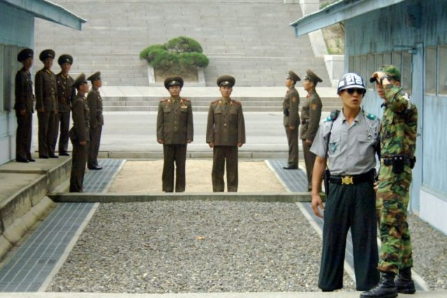 It ends here: North Korean soldiers stand just metres from their South Korean counterparts in the DMZ, one of the most tense borders on Earth
