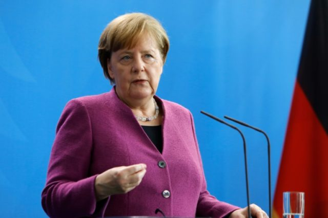 German Chancellor Angela Merkel gestures during a news conference on April 12, 2018 at the Chancellery in Berlin