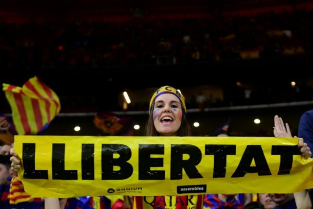 Police tried to prevent Barcelona fans from displaying support for Catalan independence