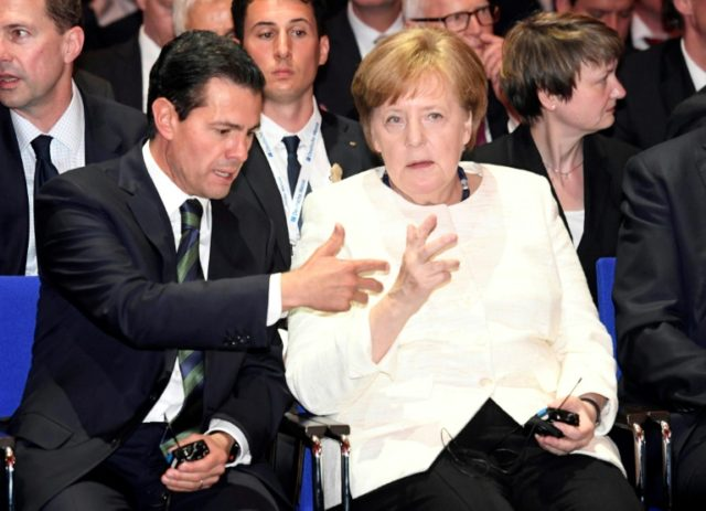 German Chancellor Angela Merkel and Mexican President Enrique Pena Nieto attend the opening ceremony of the Hannover technology fair with Mexico as the first Latin American partner country.