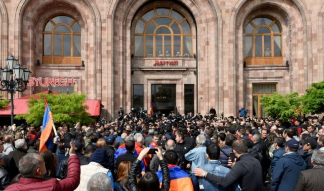 Sarkisian walked out of televised talks with Pashinyan, accusing the opposition of blackmail, as journalists and opposition supporters crowded outside the venue