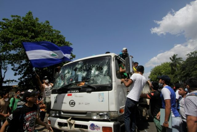Students destroy a Municipality truck during protests against government's reforms in the Institute of Social Security in Managua on April 21, 2018