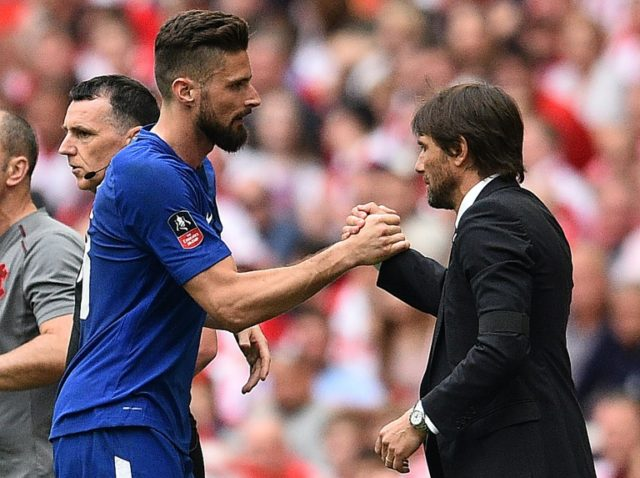 Antonio Conte shakes hands with Olivier Giroud, who got the opener in Chelsea's 2-0 FA Cup semi-final win over Southampton on Sunday