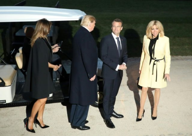 US President Donald Trump and First Lady Melania Trump stand with French President Emmanuel Macron and his wife, Brigitte Macron following a dinner at Mount Vernon, the estate of the first US President George Washington