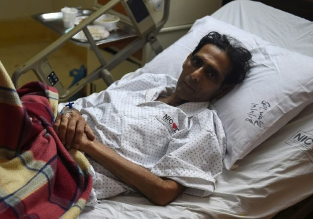 Mansoor Ahmed being treated at a hospital in Karachi
