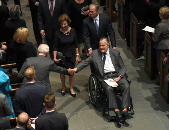 Former US President George H.W. Bush exits the funeral of his wife First Lady Barbara Bush, followed by his daughter-in-law former First Lady Laura Bush and former President George W. Bush