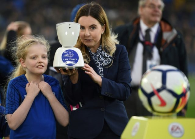 A staff member holds an AV1 telepresence robot, allowing teenage fan Jack McLinden to be a 'virtual matchday mascot' ahead of the English Premier League football match between Everton and Newcastle United at Goodison Park in Liverpool, England