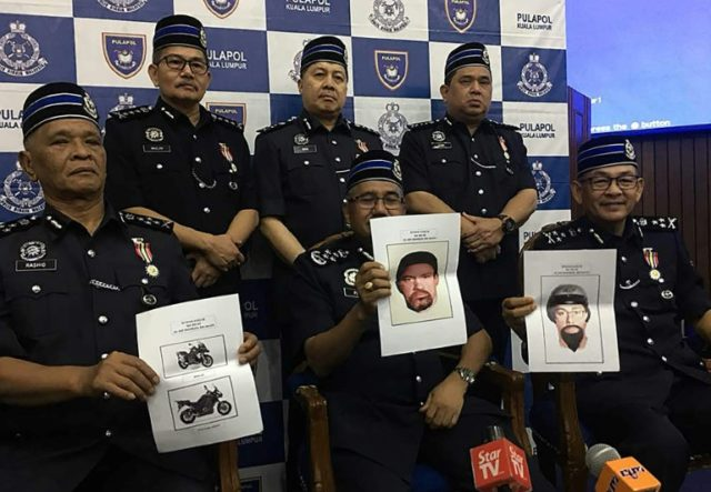 Malaysia's police chief Mohamad Fuzi Harun (C) with other police officials holding computer-generated images of the suspects