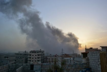 Smoke billows from an explosion in a southern district of the Syrian capital Damascus, during regime strikes targeting the Islamic State group in the Palestinian camp of Yarmuk, and neighbouring districts