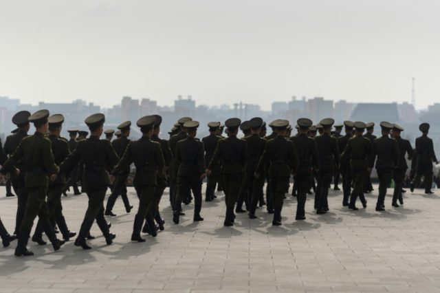 Turning their backs on all that: Just nine North Korean soliders are known to have crossed the land border into South Korea since 2000
