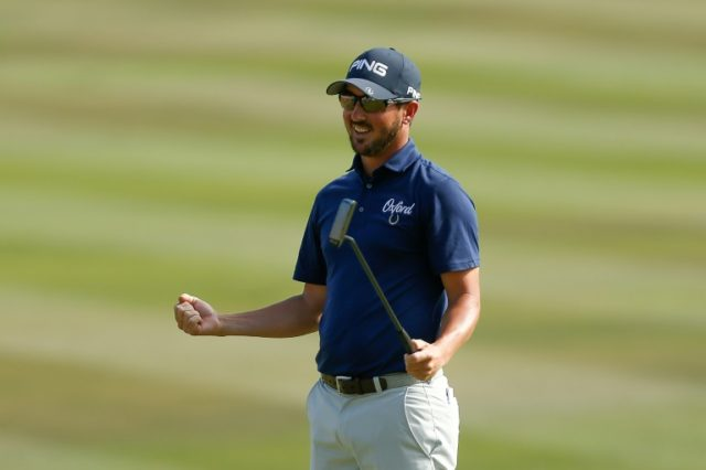 Andrew Landry celebrates on the 18th green after winning the Valero Texas Open at on April 22, 2018 in San Antonio, Texas