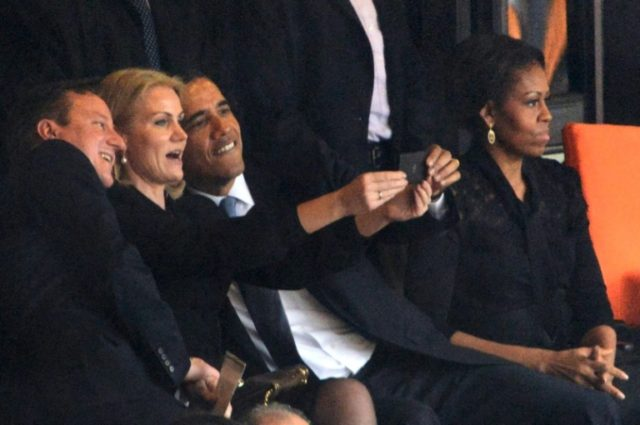 Obama and former prime ministers David Cameron of Britain and Denmark's Helle Thorning Schmidt pose for a selfie at Mandela's memorial service