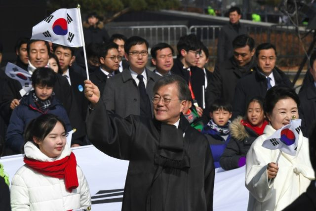 South Korean President Moon Jae-in (C) was born in a refugee camp after his parents fled the North in the Hungnam Evacuation, one of the US military's biggest-ever civilian rescues during the Korean War