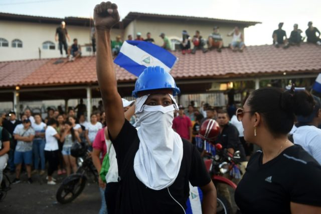 People demonstrate demanding Nicaraguan President Daniel Ortega and his wife, Vice-President Rosario Murillo, step down after deadly unrest