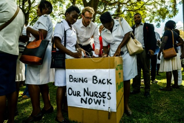 People cast their letters of complaint to Zimbabwe's deputy president after he announced the sacking of many nurses
