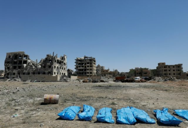 Body bags lined up of corpses recovered from a mass grave in the former Islamic State group stronghold of Raqa in Syria
