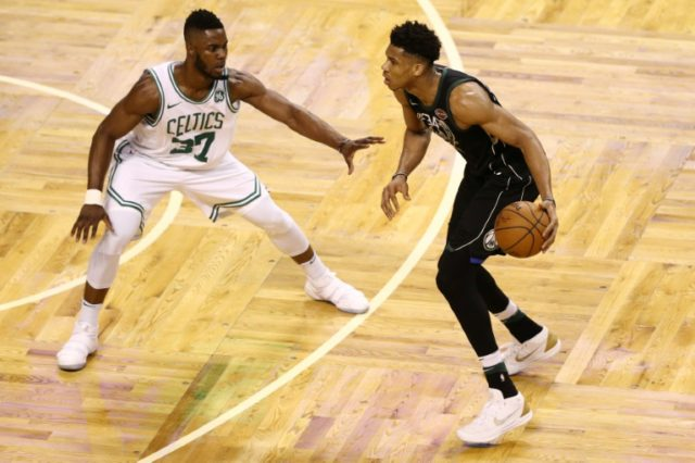 Semi Ojeleye of the Boston Celtics defends Giannis Antetokounmpo of the Milwaukee Bucks as Boston took a 3-2 series lead with a 92-87 win