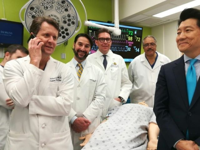 The medical team (L-R) Richard Redett, Trinity Bivalacqua, Gerald Brandacher and Arthur Bud Burnett, plus W.P. Andrew Lee, director of plastic and reconstructive surgery at the Johns Hopkins University School of Medicine, stand near a mannequin