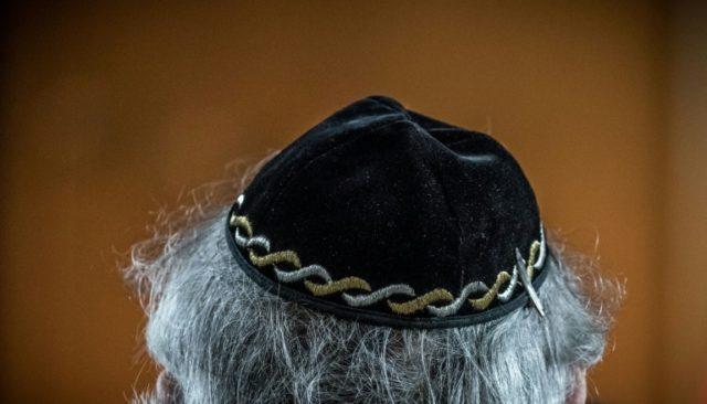 "A Jewish man wears a kippa, or Jewish religious skull cap, during a meeting on ""the German and French perspectives on immigration, integration and identity"" organised by the American Jewish Committee (AJC) on April 24, 2018 in Berlin"