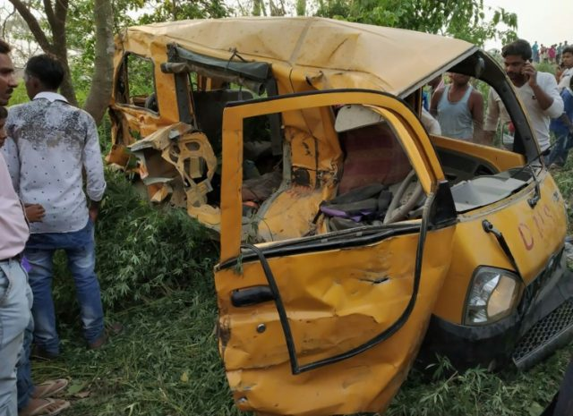 The mangled remains of a school bus after it was hit by a train, killing 13 children in India's Uttar Pradesh state