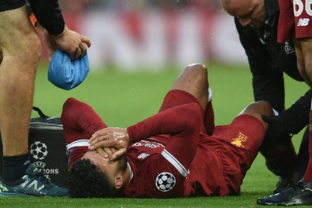 Liverpool and England midfielder Alex Oxlade-Chamberlain is treated on the pitch during the Champions League semi-final against Roma at Anfield