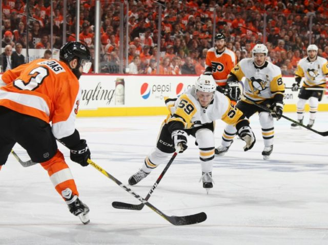 Jake Guentzel scored four unanswered goals, including two just 10 seconds apart, as the Penguins defeated the Flyers 8-5 to reach the second round of the playoffs