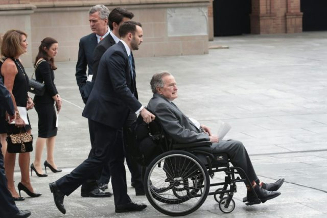 Former president George H.W. Bush leaves the funeral service of his wife Barbara Bush, the day before he was admitted to hospital